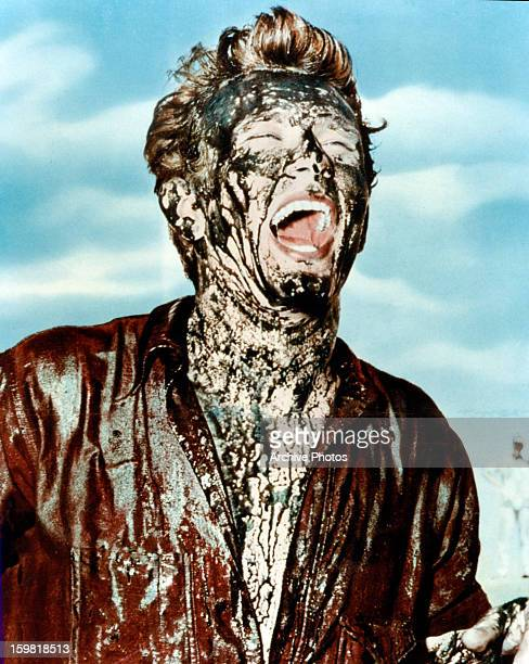 James Dean covered in oil in publicity portrait for the film 'Giant' 1956
