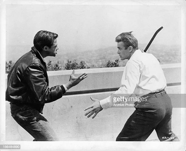 James Dean fights another man with a crow bar in a scene from the film 'Rebel Without A Cause' 1955