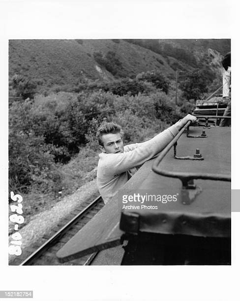 James Dean hanging from train car in a scene from the film 'East Of Eden' 1955
