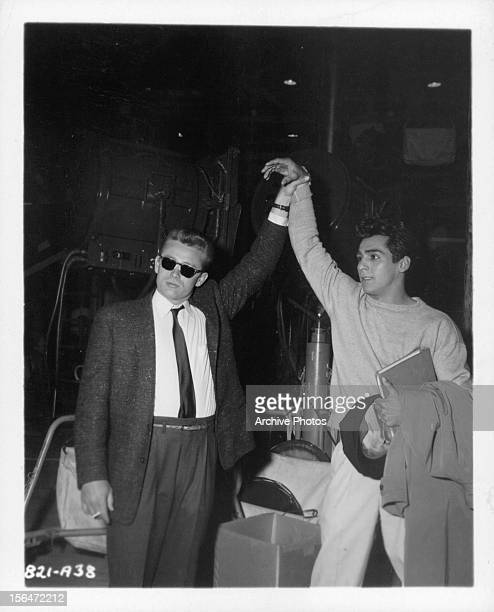 James Dean holds up the arm of Sal Mineo during a break from shooting the film 'Rebel Without A Cause' 1955