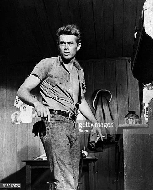 James Dean in scenes from his last movie Giant James Dean standing in 3/4 photo