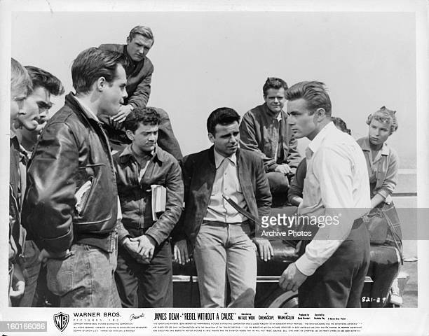 James Dean is prepared to fight as a crowd gathers to witness in a scene from the film 'Rebel Without A Cause' 1955