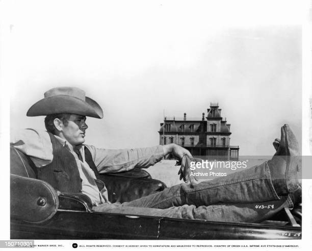 James Dean kicking back in a scene from the film 'Giant' 1956