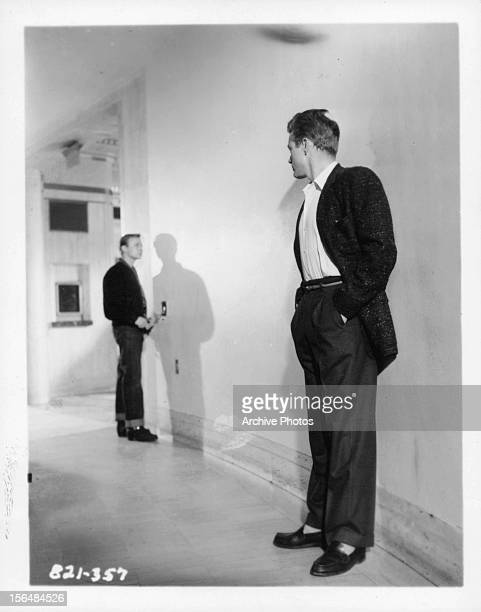 James Dean looks down a hallway in a scene from the film 'Rebel Without A Cause' 1955