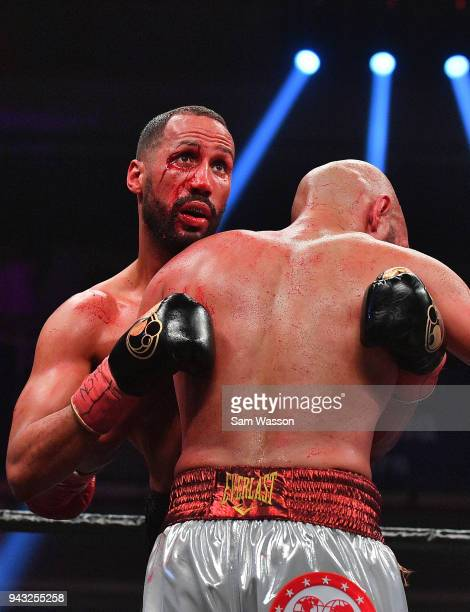 James DeGale checks the time remaining in the round as he clinches Caleb Truax during their IBF super middleweight title fight at The Joint inside...