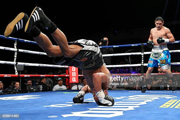 James DeGale of England rolls backwards after losing his footing against Rogelio Medina of Mexico in their IBF super middleweights championship bout...