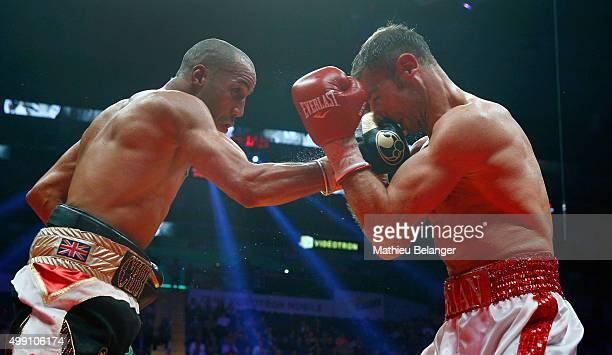 James Degale of England throws a punch to Lucian Bute of Canada during their IBF supermiddleweight championship fight at the Centre Videotron on...