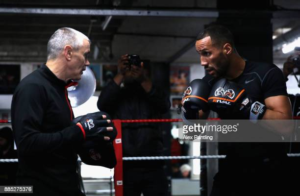 James DeGale spars with trainer Jim McDonnell during a James DeGale media workout at Stonebridge Boxing Club on December 4 2017 in London England