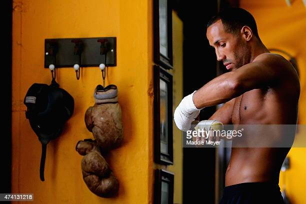 James DeGale wraps his hands during a workout in preparation for his super middleweight fight against Andre Dirrell at The Ring Boxing Club on May 20...