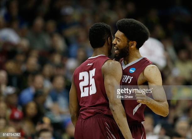 James Demery and DeAndre Bembry of the Saint Joseph's Hawks celebrate against the Oregon Ducks in the second half during the second round of the 2016...