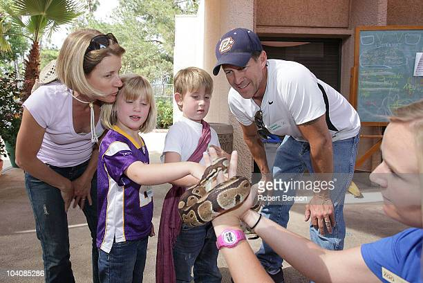 James Denton his daughter Malin son Sheppard and wife Erin watch as a zoo worker displays a python snake at the San Diego Zoo on July 31 2010 in San...