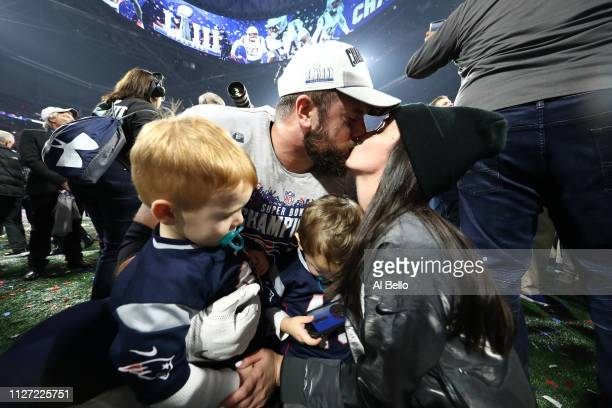 James Develin of the New England Patriots celebrates with his family after his teams 133 win over the Los Angeles Rams during Super Bowl LIII at...