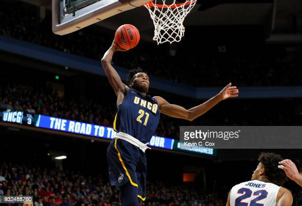 James Dickey of the UNCGreensboro Spartans dunks the ball in the first half against the Gonzaga Bulldogs during the first round of the 2018 NCAA...