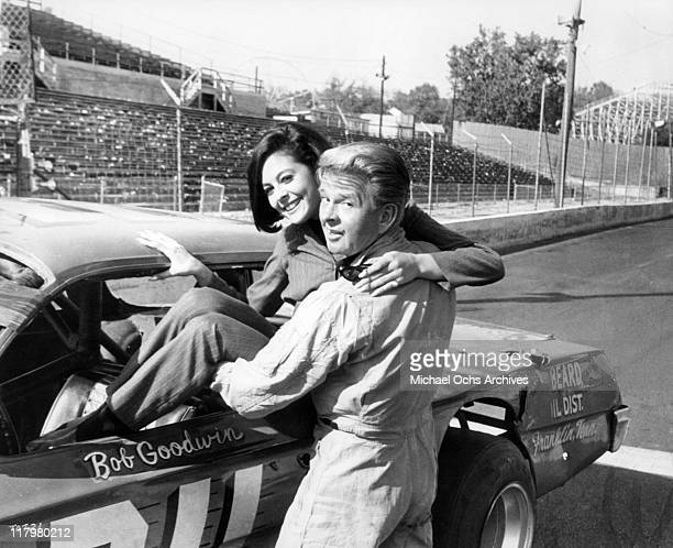 James Dobson gives Brenda Benet a lift in a scene from the film 'Track of Thunder' 1967