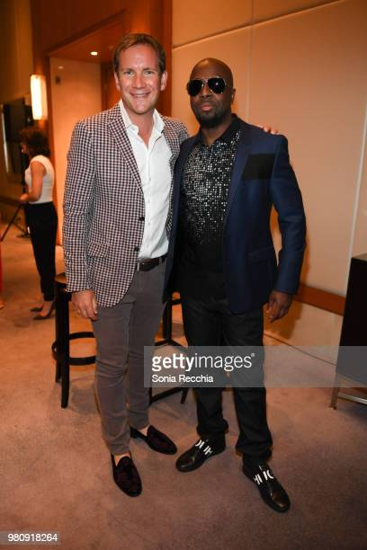 James Dodds and Wyclef Jean attend Joe Carter Classic After Party at Ritz Carlton on June 21 2018 in Toronto Canada