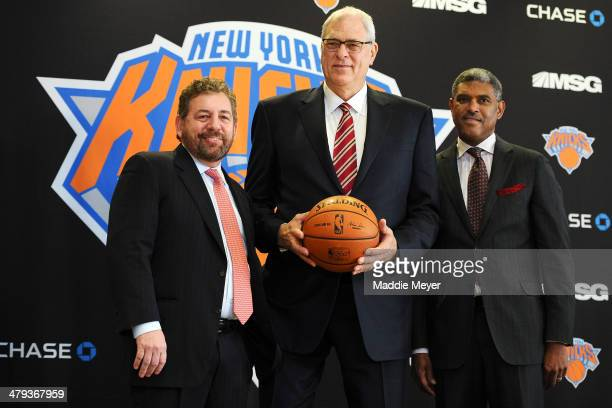 James Dolan Executive Chairman of Madison Square Garden Phil Jackson and Steve Mills General Manager of the New York Knicks stand for a photo during...