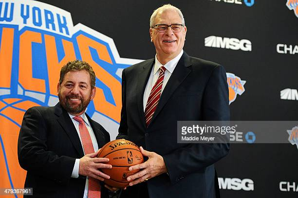 James Dolan L Executive Chairman of Madison Square Garden stands with Phil Jackson during the press conference to announce Jackson as President of...