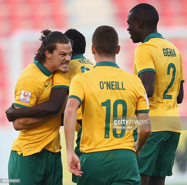 James Donachie of Australia celebrates with team mates as he scores their first goal during the AFC U23 Championship Group D match between Vietnam...