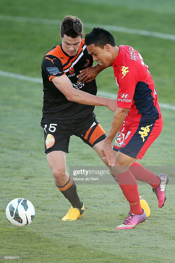 James Donachie of Brisbane competes with Iain Ramsey of Adelaide during the round 23 A-League match between Adelaide United and the Brisbane Roar at Hindmarsh Stadium on March 2, 2013 in Adelaide, Australia.