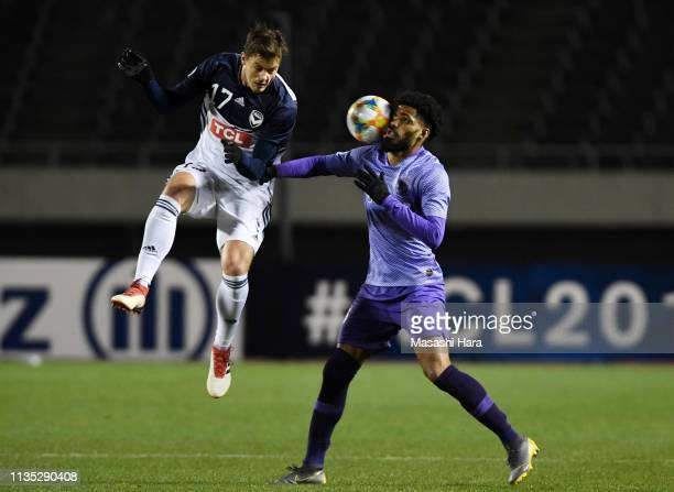 James Donachie of Melbourne Victory and Anderson Patric Aguiar Oliveira of Sanfrecce Hiroshima compete for the ball during the AFC Champions League...