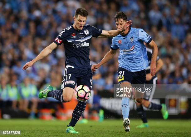 James Donachie of Melbourne Victory is challenged by Filip Holosko of Sydney FC during the 2017 ALeague Grand Final match between Sydney FC and the...
