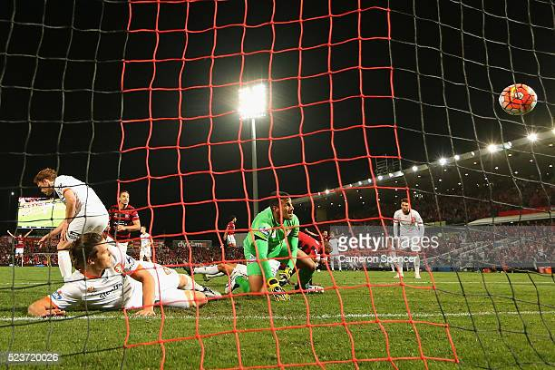 James Donachie of the Roar and goal keeper Jamie Young watch the ball as Romeo Castelen of the Wanderers scores a goal during the ALeague Semi Final...