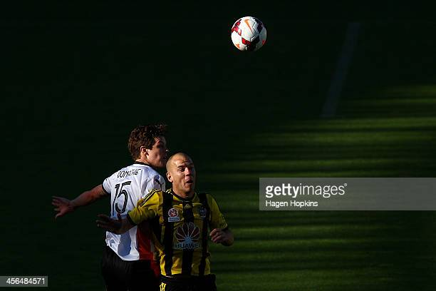 James Donachie of the Roar and Stein Huysegems of the Phoenix compete for a header during the round 10 ALeague match between the Wellington Phoenix...