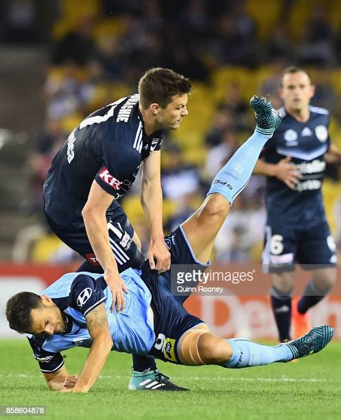 James Donachie of the Victory and Bobo of Sydney FC collide into each other during the round one ALeague match between the Melbourne Victory and...