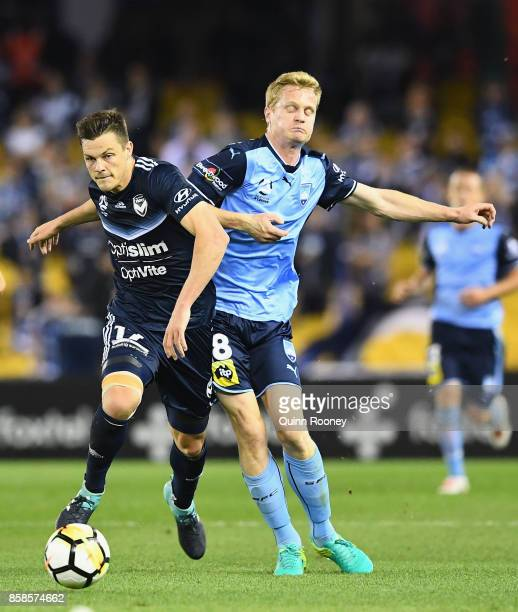 James Donachie of the Victory and Matt Simon of Sydney FC compete for the ball during the round one ALeague match between the Melbourne Victory and...