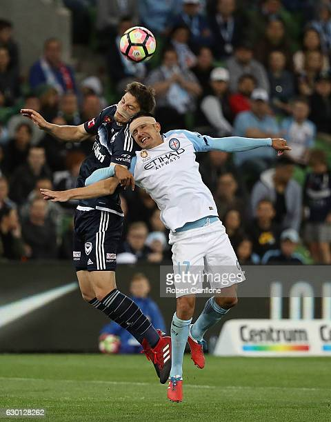 James Donachie of the Victory and Tim Cahill of Melbourne City compete for the ball during the round 11 ALeague match between Melbourne City FC and...