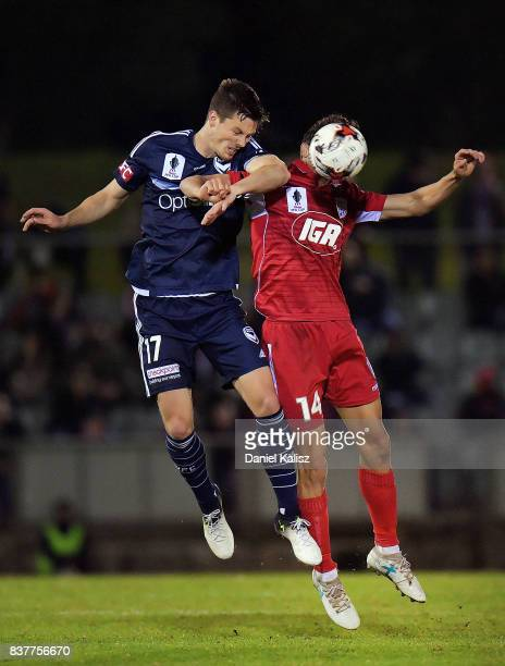 James Donachie of the Victory competes for the ball with George Blackwood of United during the round of 16 FFA Cup match between Adelaide United and...