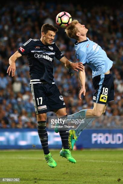 James Donachie of the Victory competes with Matthew Simon of Sydney during the 2017 ALeague Grand Final match between Sydney FC and the Melbourne...