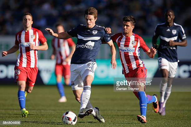 James Donachie of the Victory kicks the ball during the match between Melbourne Victory and Atletico de Madrid at Simonds Stadium on July 31 2016 in...