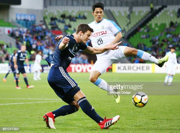 James Donachie of the Victory kicks the ball past Kei Chinen of Kawasaki Frontale during the AFC Asian Champions League match between the Melbourne...