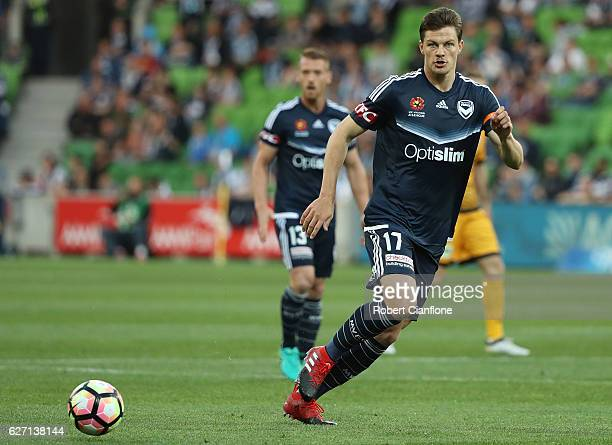 James Donachie of the Victory passes the ball during the round nine ALeague match between Melbourne Victory and Perth Glory at AAMI Park on December...