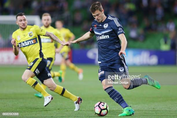 James Donachie of the Victory runs with the ball during the round 27 ALeague match between the Melbourne Victory and the Central Coast Mariners at...