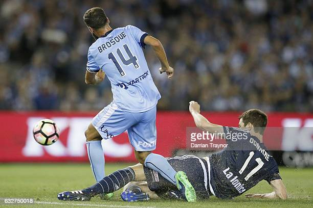 James Donachie of the Victory takes down Alex Brosque of Sydney FC during the round 17 ALeague match between the Melbourne Victory and Sydney FC at...