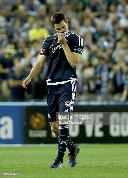 James Donachie of the Victory walks off the ground after he was sent off during the round 17 ALeague match between the Melbourne Victory and Sydney...