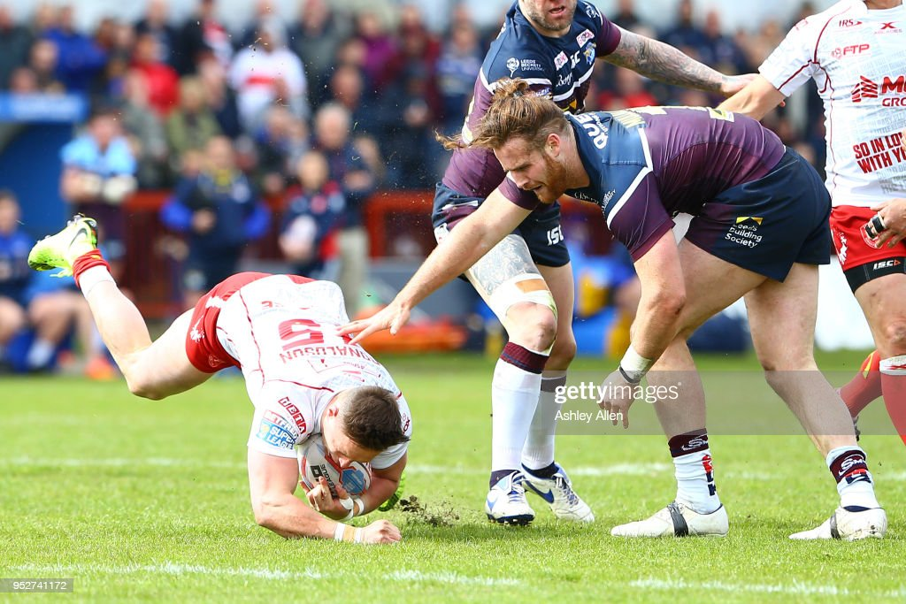 James Donaldson of Hull KR goes down after being tackled by Anthony Mullally of Leeds Rhinos during the BetFred Super League match between Hull KR and Leeds Rhinos at KCOM Craven Park on April 29, 2018 in Hull, England.