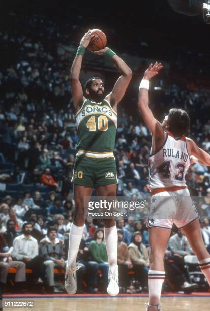 James Donaldson of the Seattle Supersonics shoots over Jeff Ruland of the Washington Bullets during an NBA basketball game circa 1982 at the Capital...