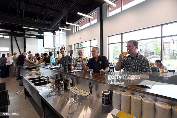 James Dorman Steven Hacker Fred David and Doug Nett all from Dallas TX friends of Charlie Gottenkieny owner of Bruz Beer in the new Midtown...