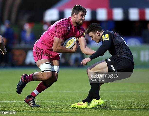 James Down of London Welsh is tackled by Duncan Taylor of Saracens during the Aviva Premiership match between Saracens and London Welsh at Allianz...