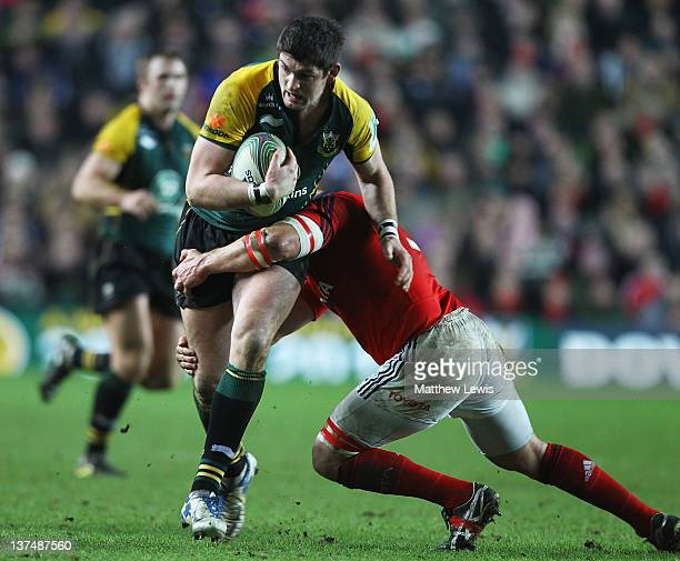 James Downey of Northampton is tackled by BJ Botha of Munster during the Heineken Cup match between Northampton Saints and Munster at StadiumMK on...