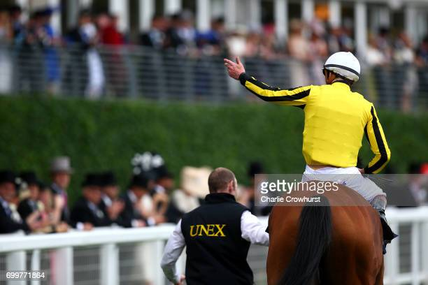 James Doyle celebrates after he rides Big Orange to win The Gold Cup ahead of Ryan Moore on Order of St George on day 3 'Ladies Day' of Royal Ascot...