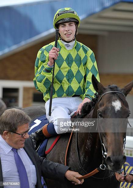James Doyle celebrates riding Louis The Pious to victory in the The William Hill Ayr Gold Cup on September 20 2014 in Ayr Scotland