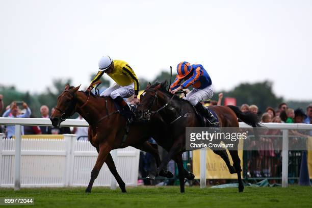 James Doyle rides Big Orange to win The Gold Cup ahead of Ryan Moore on Order of St George on day 3 'Ladies Day' of Royal Ascot at Ascot Racecourse...