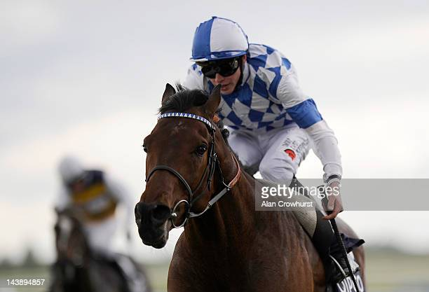James Doyle riding Al Kazeem win The Qatar Bloodstock Jockey Club Stakes at Newmarket racecourse on May 05 2012 in Newmarket England