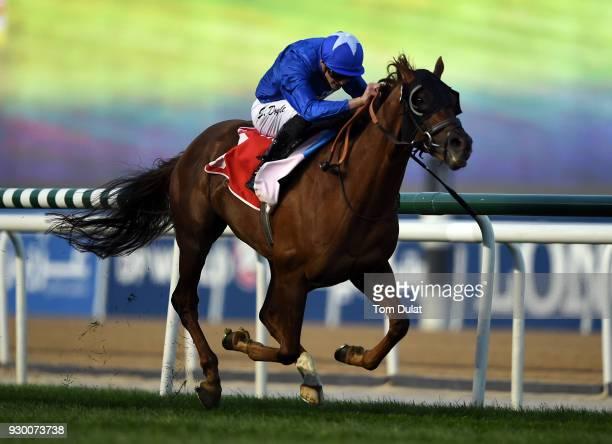 James Doyle riding Blair House wins the Jebel Hatta race during Dubai World Cup Carnival Races at the Meydan Racecourse on March 10 2018 in Dubai...