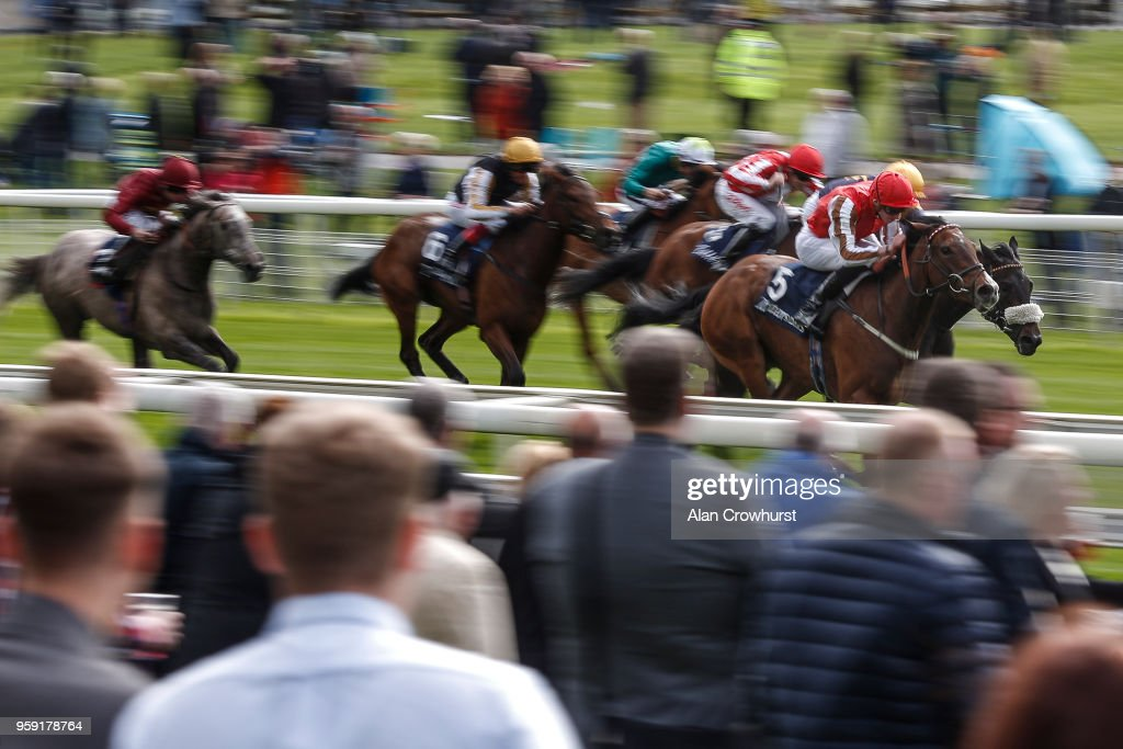 James Doyle riding Give And Take (R, red) win The Tattersalls Musidora Stakes at York Racecourse on May 16, 2018 in York, United Kingdom.