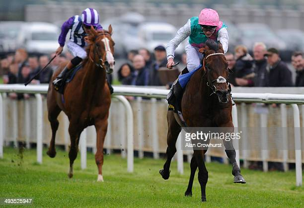 James Doyle riding Kingman win The Tattersalls Irish 2000 Guineas at Curragh racecourse on May 24 2014 in Kildare Ireland